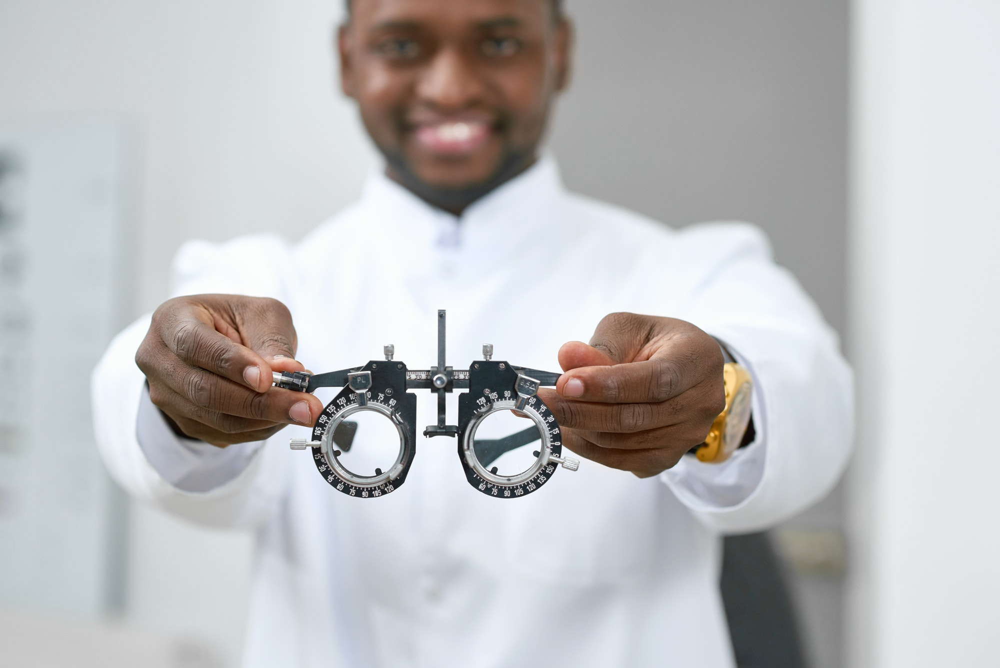 Smiling man giving medical lenses to try on